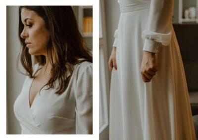 kopertowa suknie ślubna z rękawem na guziczki.